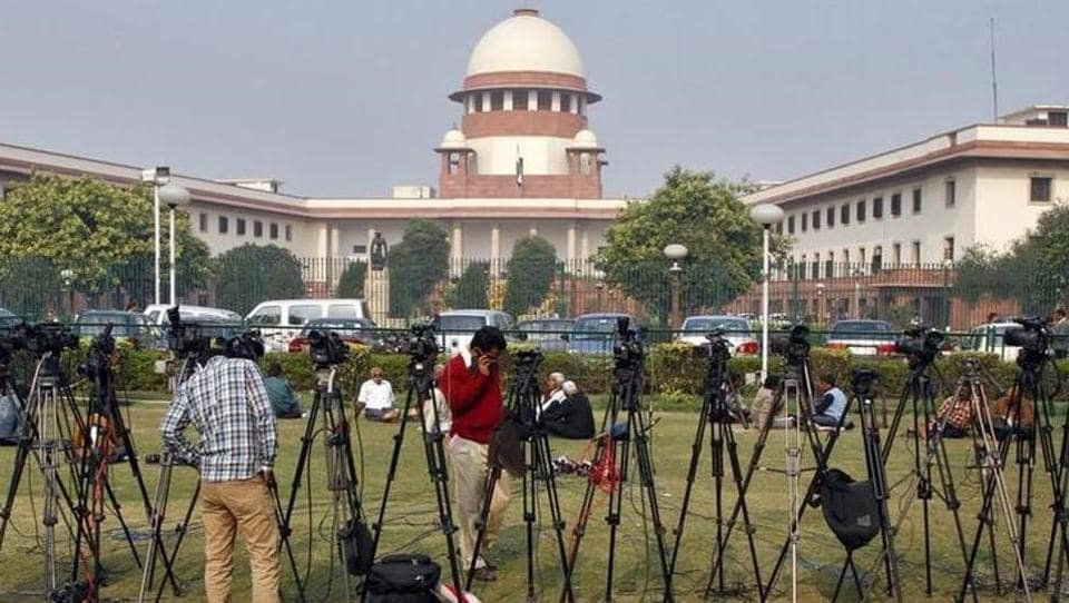 Tripods of television crew stand in front of the Supreme Court building in New Delhi.