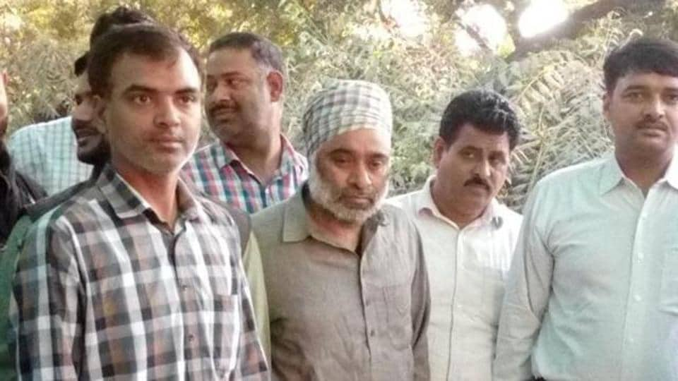 Khalistan Liberation Force chief Harminder Singh Mintoo, centre, was arrested from the railway station in Delhi.