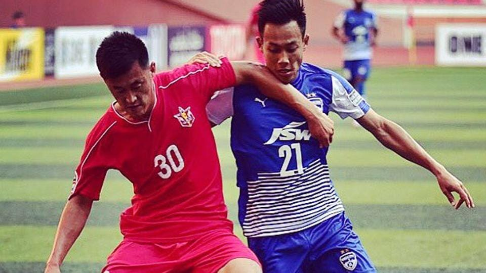 Bengaluru FC's Udanta Kumam (right)vie for the ball with a 4.25 SC during their AFCCup Inter-Zone semifinal match at May Day Stadium in Pyongyang, North Korea, on Wednesday
