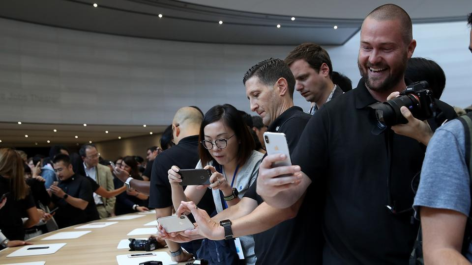 An attendee looks at a new iPhone X during an Apple special event at the Steve Jobs Theatre on the Apple Park campus on September 12 in Cupertino, California.