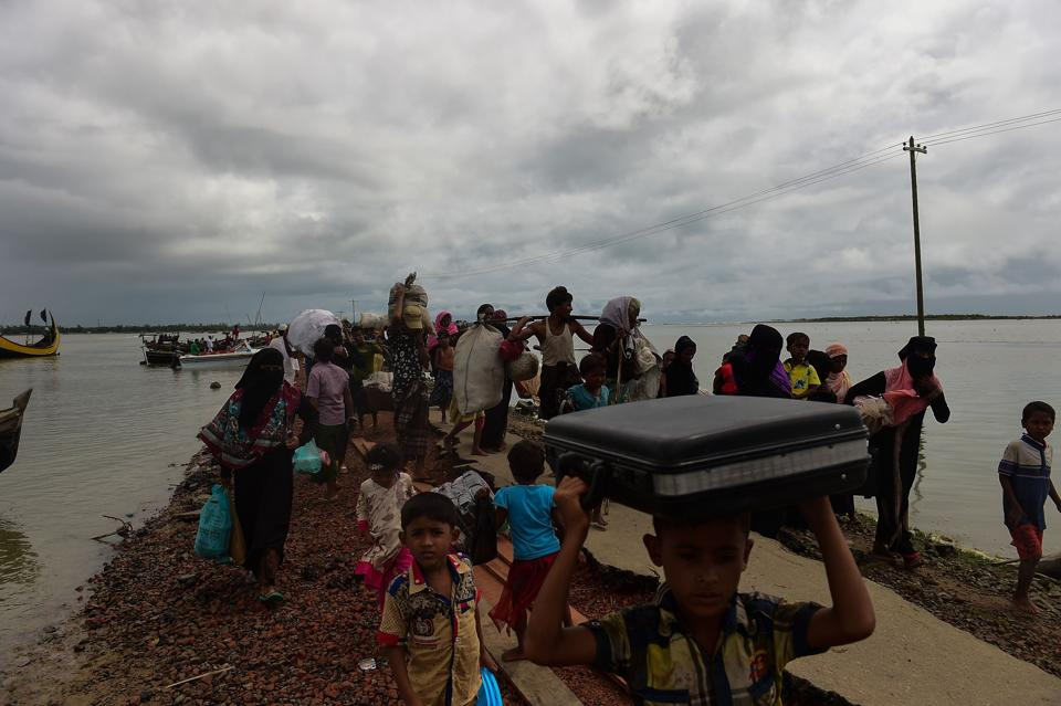 Rohingya refugees arrive from Myanmar after crossing the Naf river in the Bangladeshi town of Teknaf on September 12, 2017.
