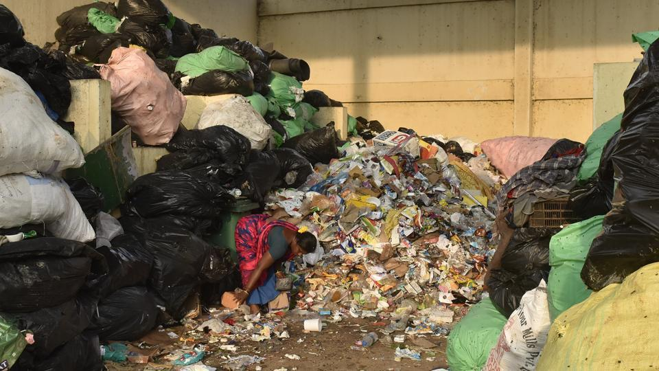 A woman working at a dry waste collection centre of Bruhat Bengaluru Mahanagara Palike. The good news is that 40–60% of India's municipal solid waste consists of compostable matter. But to generate quality compost, municipalities have to ensure that wet waste is segregated properly. Mixed waste can add toxicity to the produce, making it harmful for agriculture or gardening.  (Arijit Sen / HT Photo)