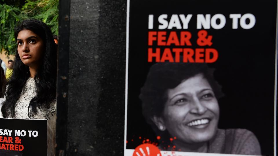 Demonstrators hold placards with the picture of Indian journalist Gauri Lankesh during a 'Not In My Name' protest in New Delhi on September 7.