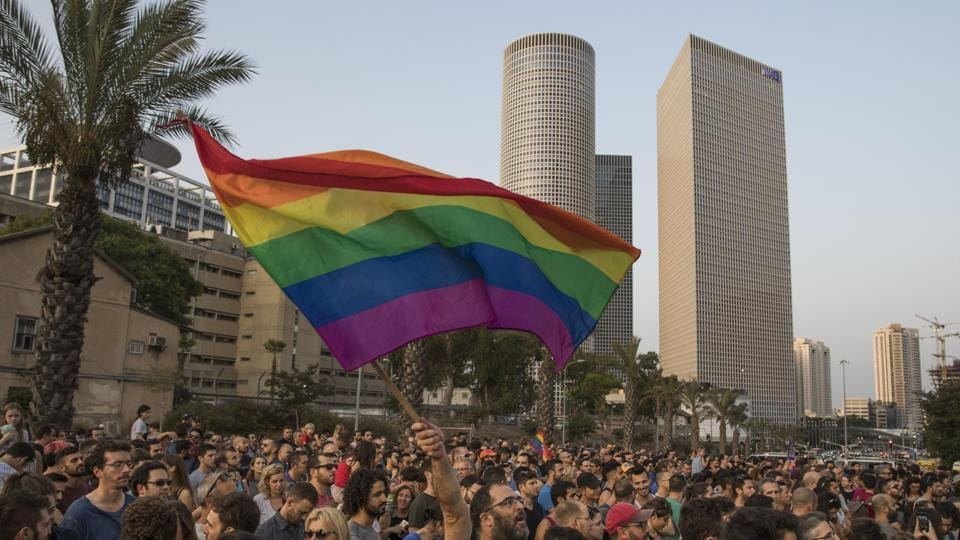 An Israeli man waves a rainbow flag during a demonstration in Tel Aviv, Israel on July 20. Though the country is considered a trailblazer in the promotion of and respect for gay rights, homosexuality remains taboo among the religious and ultra-Orthodox parties.