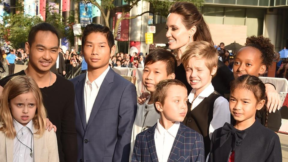 (L-R) Loung Ung, Vivienne Jolie-Pitt, Maddox Jolie-Pitt, Pax Jolie-Pitt, Angelina Jolie, Kimhak Mun, Knox Jolie-Pitt, Shiloh Jolie-Pitt, Zahara Jolie-Pitt and Sareum Srey Moch attend the First They Killed My Father premiere during the 2017 Toronto International Film Festival at Princess of Wales Theatre.
