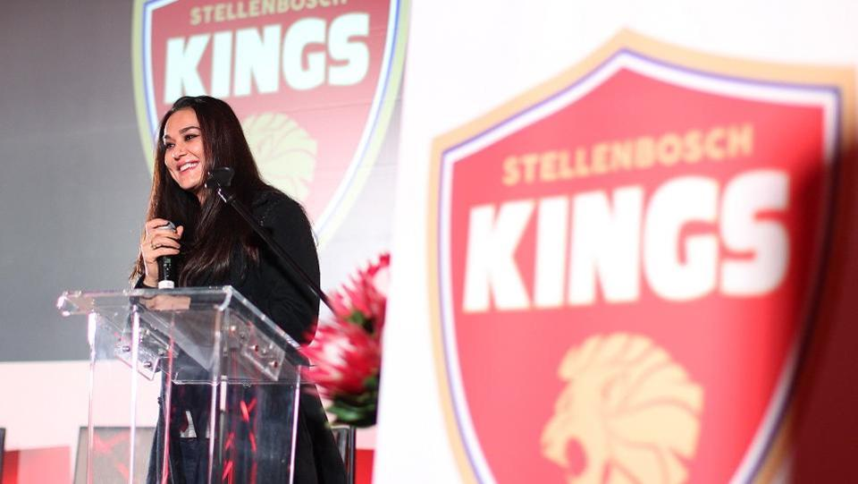 Preity Zinta, owner of the South Africa T20 Global League team Stellenbosch Kings, unveils its logo at Val de Vie Estate in Paarl, South Africa, on Wednesday.