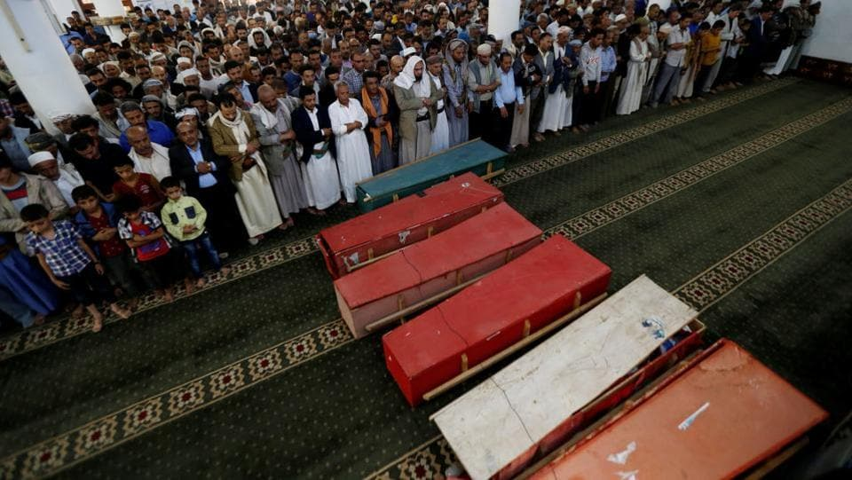 Mourners perform prayers during the funeral of eight family members killed by a Saudi-led air strike in Sanaa, on August 26, 2017. Only one girl, Buthaina Muhammad Mansour, aged between four and five years old, survived the strike. In most of its internal investigations, the coalition either admits making mistakes due to technical errors, bad intelligence or denies responsibility. (Khaled Abdullah / REUTERS)