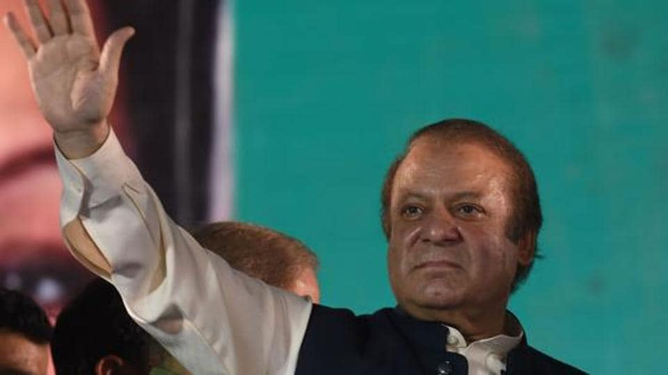 Ousted Pakistani prime minister Nawaz Sharif gestures as he addresses supporters at a rally after reaching his home city of Lahore on August 12.