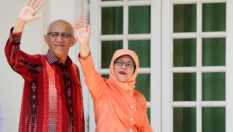 Former speaker of Singapore's parliament, Halimah Yacob, arrives with her husband Mohammed Abdullah Alhabshee to submit her presidential nomination papers at the nomination centre in Singapore September 13, 2017.