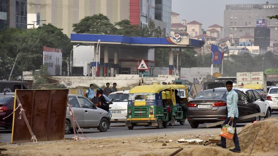 Vehicles on a road in front of a petrol pump at MG Road near IFFCO Chowk, Gurgaon, India.