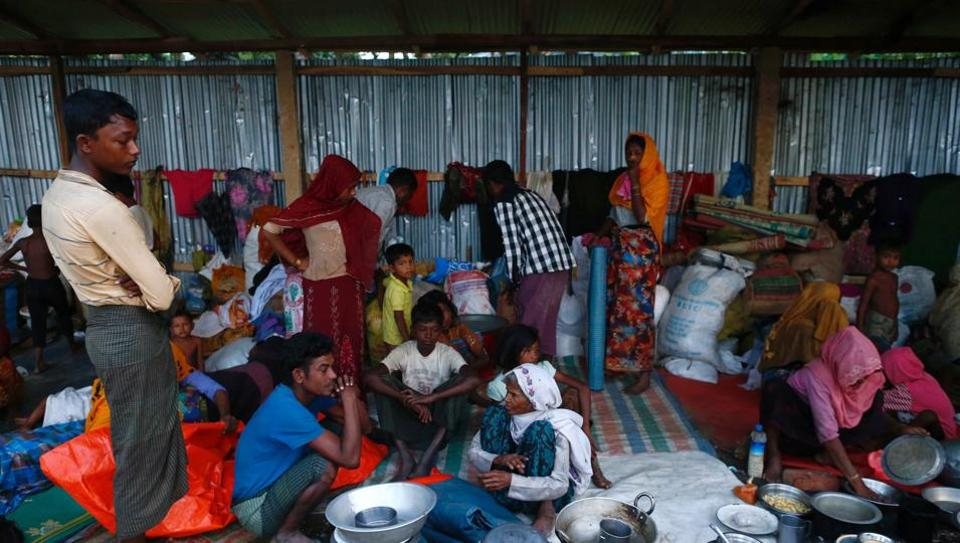 Rohingya refugees go about their day inside their temporary shelter near Balukhali in Cox's Bazar, Bangladesh, September 13, 2017.