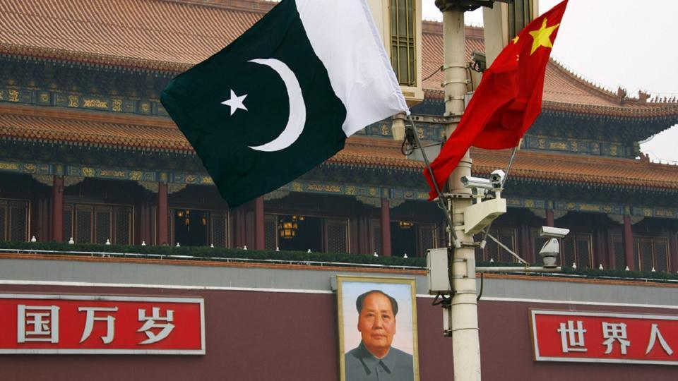 A Pakistan national flag flies alongside a Chinese national flag in front of the portrait of Chairman Mao Zedong at Beijing's Tiananmen Square (File Photo)