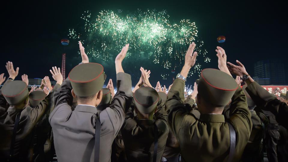 In a photo taken on September 6, 2017, Korean People's Army (KPA) soldiers cheer during a mass celebration in Pyongyang for scientists involved in carrying out North Korea's largest nuclear blast to date. Last month's ICBM launch was followed by a nuclear test on September 3, its largest to date, which Pyongyang said was a hydrogen bomb small enough to fit onto a missile. (Kim Won-Jin / AFP)