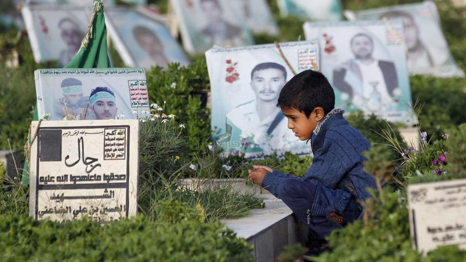 A Yemeni child sits next to the grave of a loved one in a cemetery in the capital Sanaa on September 1, 2017, on the morning of the first day of Eid al-Adha. Airstrikes the past two years have targeted civilian gatherings at weddings, funerals, hospitals, markets and houses. Over 10,000 people have been killed and three million others displaced as the conflict coupled with a naval and air blockade has pushed Yemen to the brink of famine. (Mohammed Huwais / AFP)