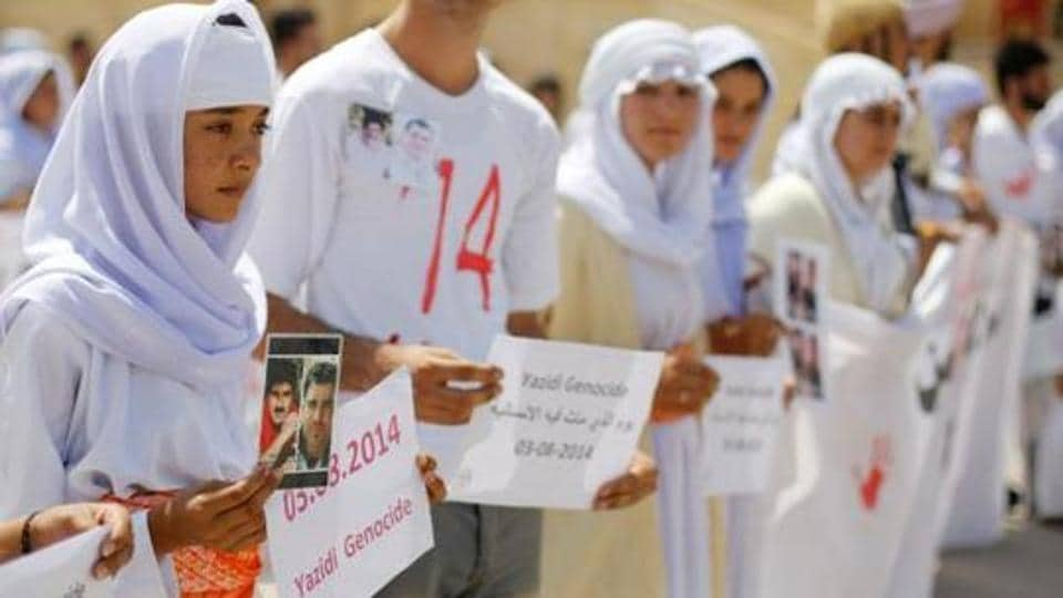Yazidis attend a commemoration of the third anniversary of the Yazidi genocide in Sinjar region, Iraq August 3, 2017.