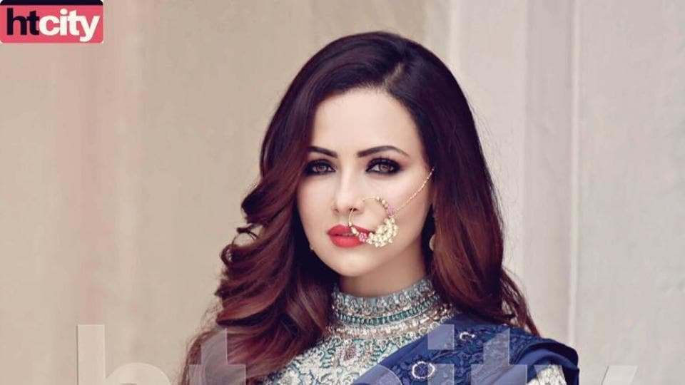 Actor Sana Khan donning a blue lehenga and ditching cliches