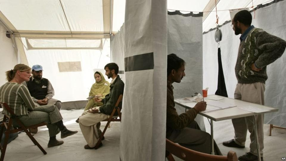 A man from the Pakistani Kashmiri village of Dak talks about his earthquake experiences during a psychotherapy session with psychologists of the MSF medical charity, at a tent clinic in the town of Bagh, Oct. 29, 2005.