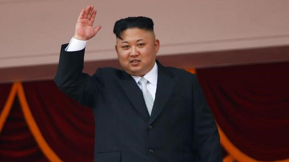 North Korean leader Kim Jong Un waves to people attending a military parade marking the 105th birth anniversary of country's founding father, Kim Il Sung in Pyongyang, April 15, 2017.