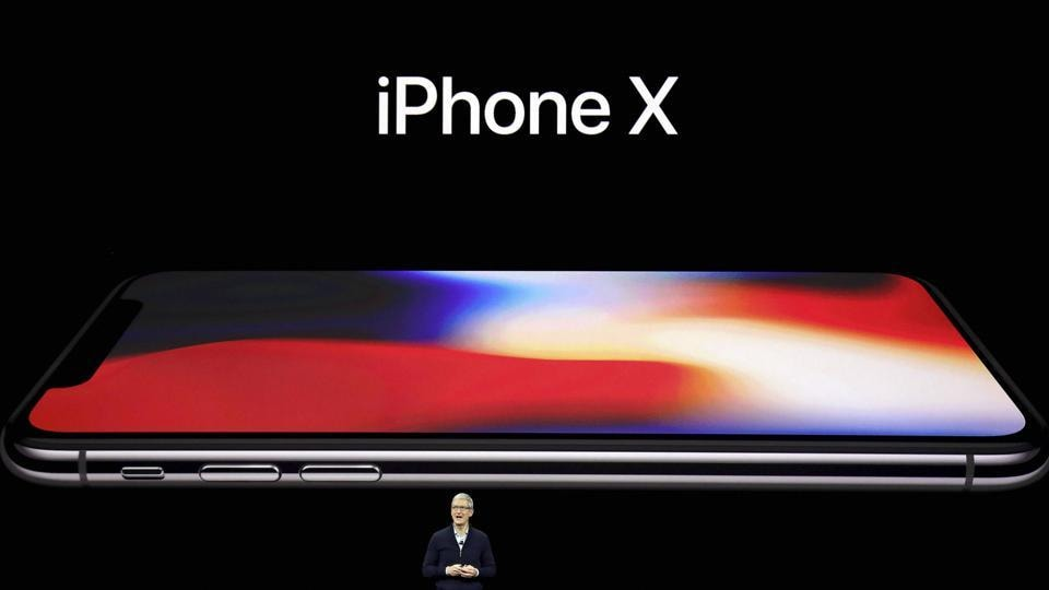 Apple CEO Tim Cook, announces the new iPhone X at the Steve Jobs Theater on the new Apple campus on Tuesday, Sept. 12, 2017, in Cupertino, Calif.