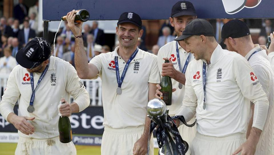 The England cricket team celebrate after winning the test series against the West Indies at Lord's cricket ground in London on Saturday, Sept. 9, 2017.