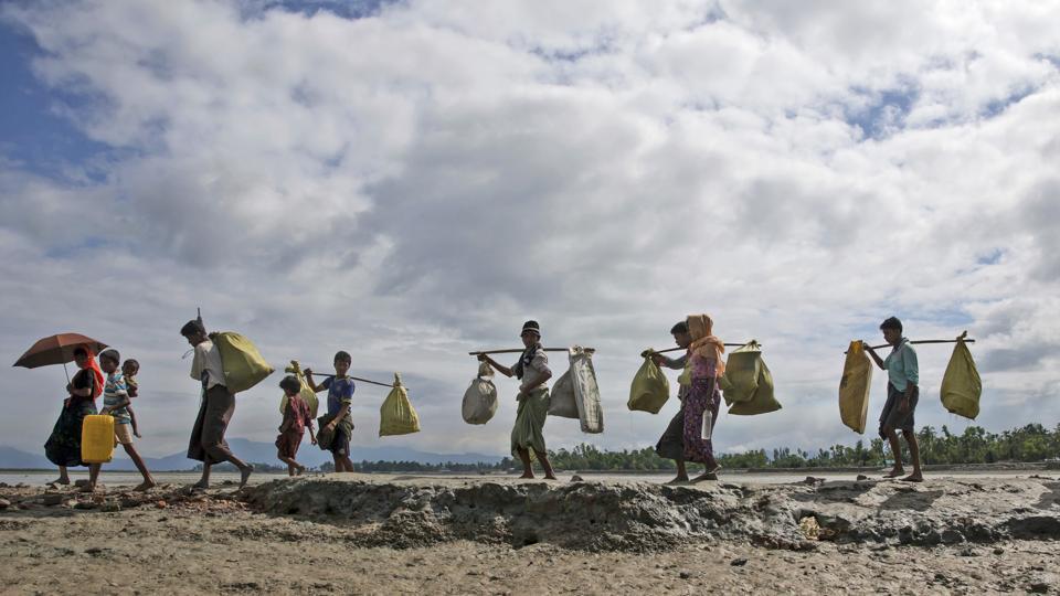 Rohingya Muslims, who crossed over from Myanmar into Bangladesh, walk towards a refugee camp in Shah Porir Dwip, Bangladesh.