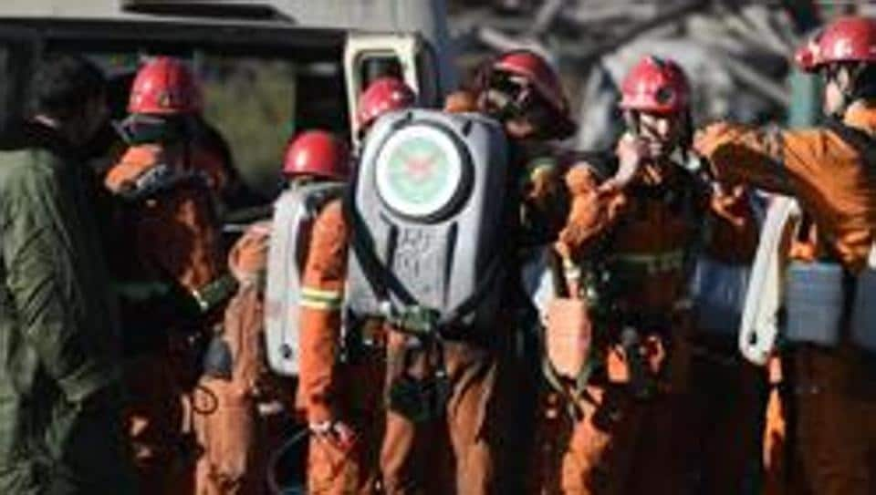 In this photo released by China's Xinhua News Agency, rescuers prepare to enter a coal mine in Shizuishan in northwestern China's Ningxia Hui Autonomous Region Wednesday, Sept. 28, 2016.