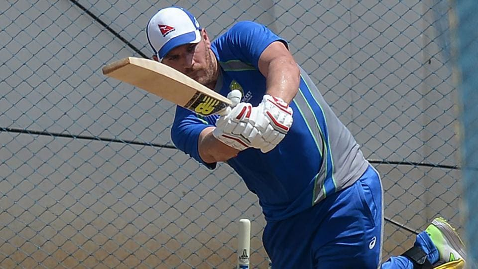 Aaron Finch plays a shot during a training session ahead of the India-Australia cricket series in Chennai on September 11, 2017. He is a doubt for Australia's opening one-day international with India on Sunday after leaving training on Thursday with a calf problem.