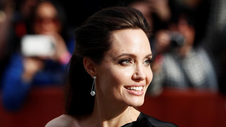 Director Angelina Jolie arrives on the red carpet for the film First They Killed My Father at the Toronto International Film Festival.