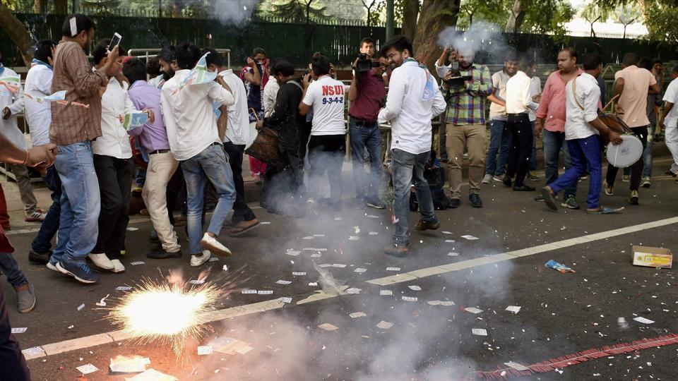 NSUI supporters celebrate outside 10 Janpath after their candidates won two posts DUSU polls.