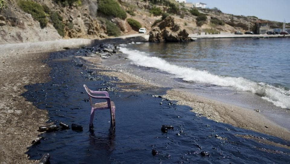 A 45-year-old vessel, the Agia Zoni II, carrying 2,500 tonnes of fuel sank off the island of Salamis, Greece on Sunday. A thick oily tide had since covered stretches of the Athens Riviera for miles. Greek officials fumbled their response to the minor oil spill which now threatens beaches near Athens five days after the sinking of the tanker, environmental groups said Thursday. (Petros Giannakouris / AP)