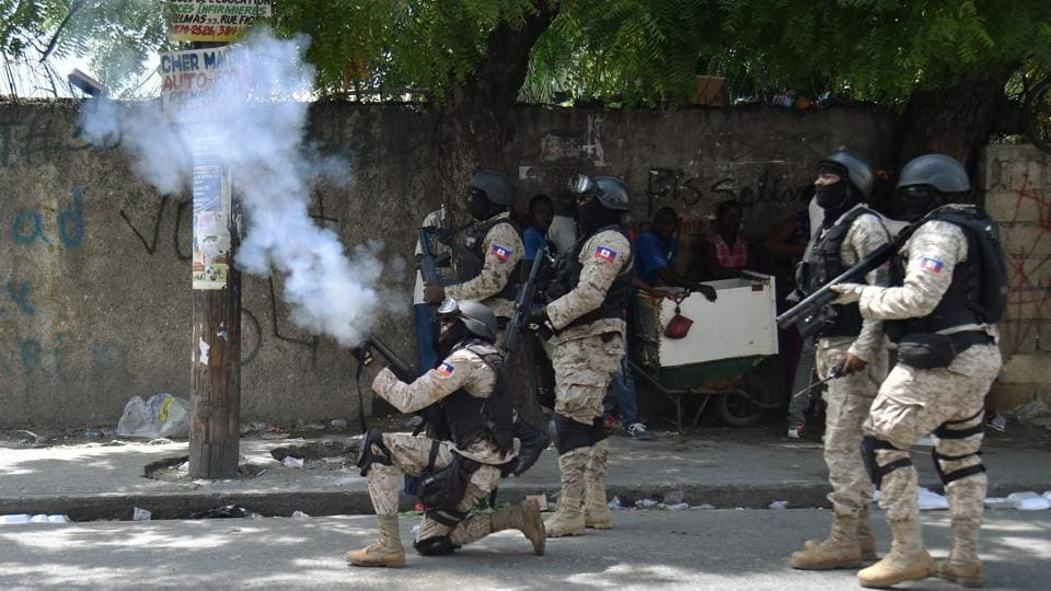 Haitian police fire tear gas to disperse protesters during an anti-government demonstration in the centre Port-au-Prince. Protesters took to the streets in separate groups, erecting flaming barricades, blocking traffic, and confronting riot police, who fired tear gas and warning shots in the air. (Hector Retamal / AFP)
