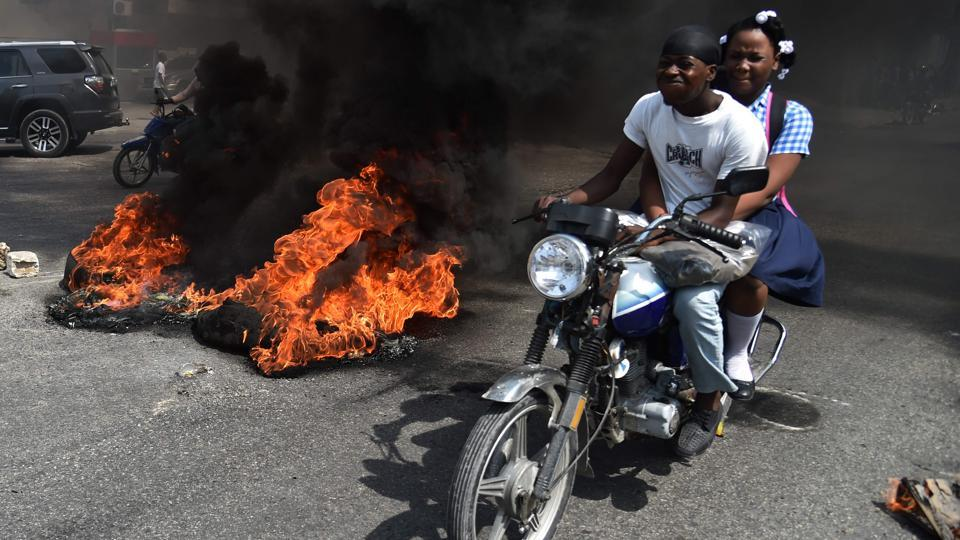 Protesters brought parts of the Haitian capital Port-au-Prince to a standstill, setting vehicles alight and damaging local businesses in violent demonstrations against the government's 2017-18 budget plans. Demonstrators took to the streets, throwing stones at the police, setting tires on fire and blocking some streets at a time when foreign aid is declining. (Hector Retamal / AFP)