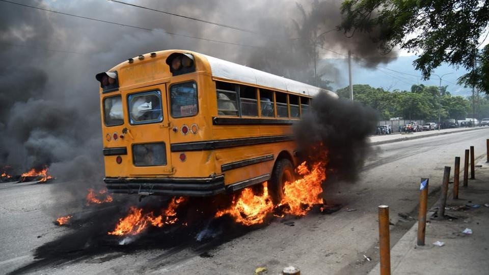 A bus with passengers aboard drives over burning tires placed by demonstrators. At the same time, foreign aid to Haiti is slowing. The country is one of the poorest in the Americas and suffered a devastating earthquake in 2010 and the worst of hurricane Matthew last year. 'If Jovenel Moise is intelligent, he should refrain from publishing the budget, otherwise he will have to face a series of street demonstrations that will further complicate the situation,' Jean-Charles Moise said on local radio. (Hector Retamal / AFP)