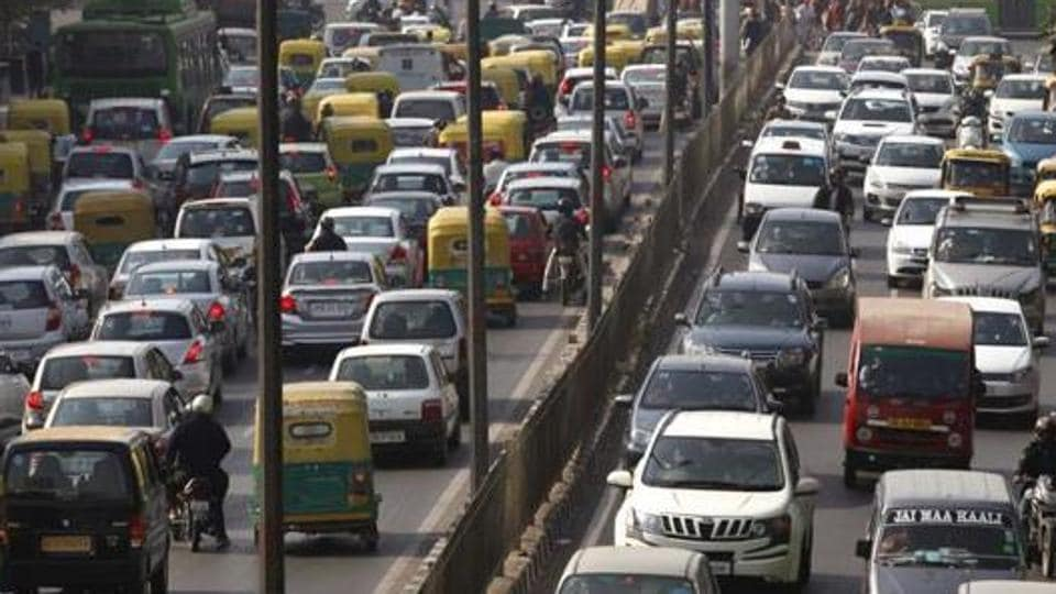Cars and buses clogs a road in New Delhi on December 16, 2015.