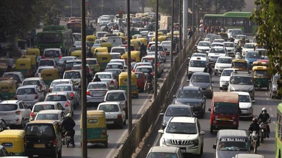 Cars and buses clogs a road in New Delhi, India, Wednesday, Dec. 16, 2015.