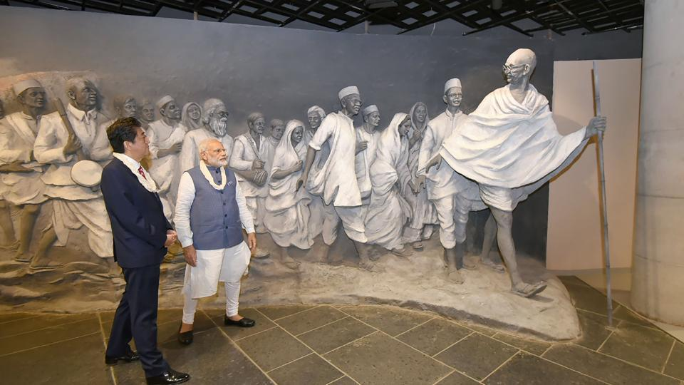 This handout photograph released by the Press Information Bureau shows Prime Minister Narendra Modi with his Japanese counterpart Shinzo Abe at the Dandi Kutir museum in Gandhinagar on Thursday.