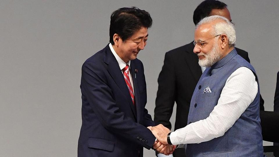 Prime Ministers Shinzo Abe shakes hands with Narendra Modi at the India-Japan Bussiness Plenary session during the India-Japan Annual summit at the Mahatama Mandir convention center in Gandhinagar on September 14, 2017.