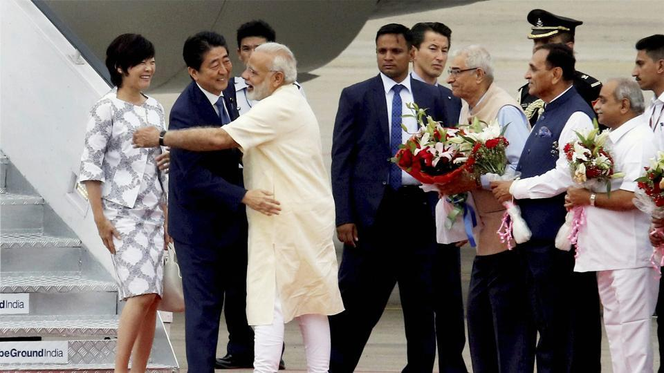 Prime Minister Narendra Modi went to Sardar Vallabhbhai International airport to receive his Japanese counterpart. PM Abe was welcomed with ceremonial reception on his arrival at the airport and was presented a guard of honour. Abe's aircraft had the tricolour along with the Japanese flag. (PTI)