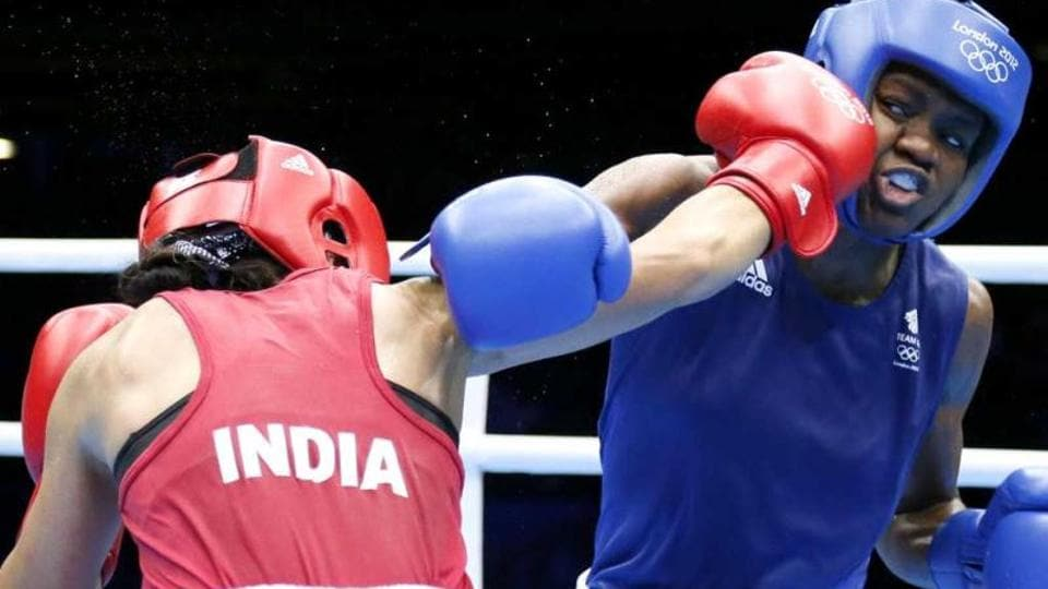 MC Mary Kom defends against Nicola Adams of Great Britain during the women's Flyweight boxing semi-finals of the 2012 London Olympic Games at the ExCel Arena. IMAGEFORREPRESENTATIVEPURPOSESONLY.