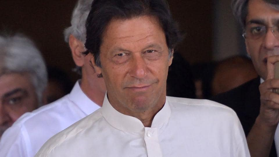 Pakistani opposition leader and head of the Pakistan Tehreek-i-Insaf (PTI) party Imran Khan leaves the Supreme Court after attending a hearing on the Panama Papers case in Islamabad on May 22, 2017.