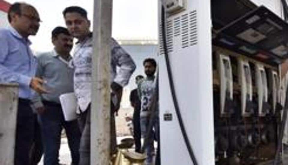 Authorities inspect a fuel station at Golf Course Ext. Road in Gurgaon.