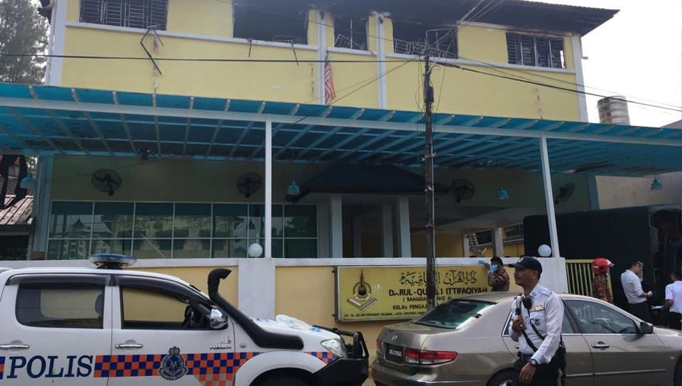 Police and fire department work at the religious school Darul Quran Ittifaqiyah after a fire broke out in Kuala Lumpur, Malaysia September 14, 2017.