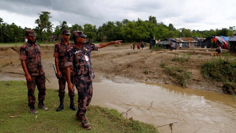 Lieutenant Colonel Monzurul Hassan Khan, a commanding officer of the Border Guards Bangladesh (BGB), speaks as Rohingya refugees stand outside their temporary shelters at no man's land between Bangladesh-Myanmar border, in Cox's Bazar, Bangladesh September 9, 2017.