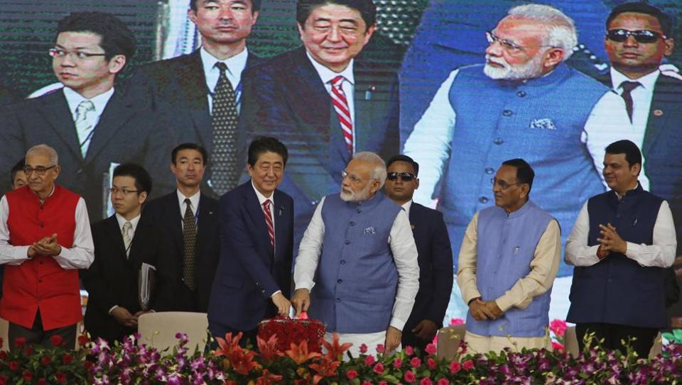 Japanese Prime Minister Shinzo Abe, center left and Indian Prime Minister Narendra Modi, center right, press a button to launch a high speed rail project in Ahmadabad, India, Thursday, Sept. 14, 2017.