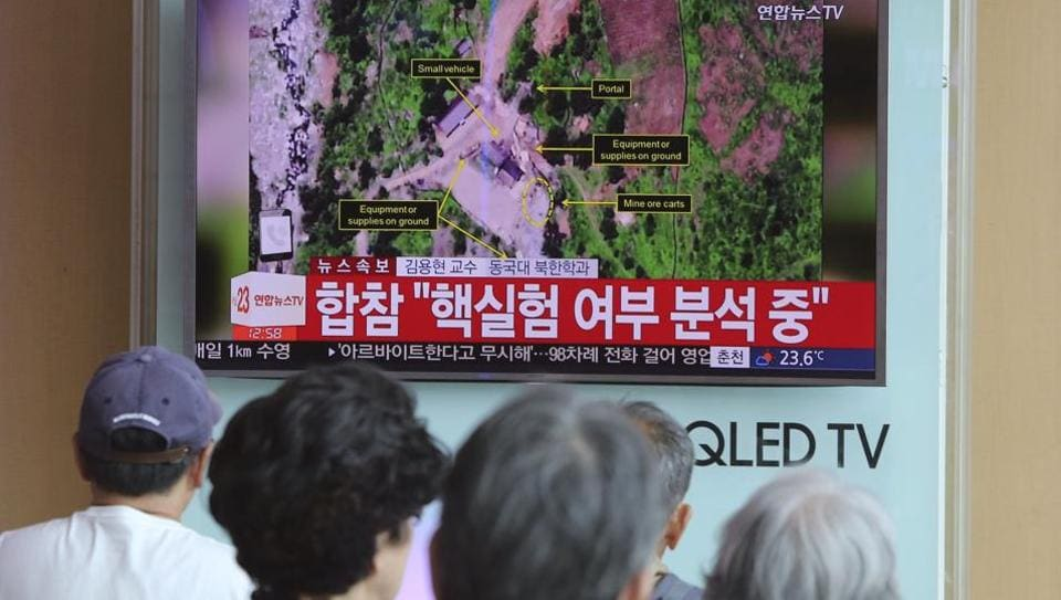 People watch a TV news reporting about a possible nuclear test conducted by North Korea ,at the Seoul Railway station in Seoul, South Korea.
