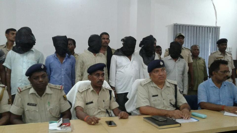 The arrested teachers and panchayat secretaries at a police station in Bihar's Arwal district.