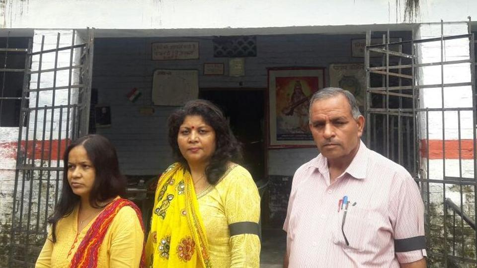 Teachers attend school with black arm bands in Dehradun on Thursday.