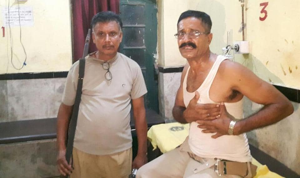 Attacked by the sand mafia in Bihar's Vaishali district, injured assistant sub-inspector Yugal Kishore Singh (right) is undergoing treatment at the Hajipur sadar hospital.