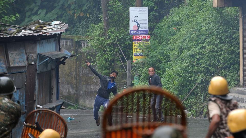 File picture of Gorkhaland supporters throwing stones at policemen in Darjeeling.