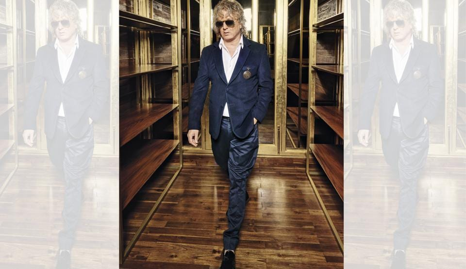 Fashion designer Rohit Bal. (Rohit Bal wears a two-button jacket with a copper broach, teamed with a shirt and indigo gabardine jodhpurs; sunglasses from Ray-Ban, shoes from Tod's, and watch from Breitling)